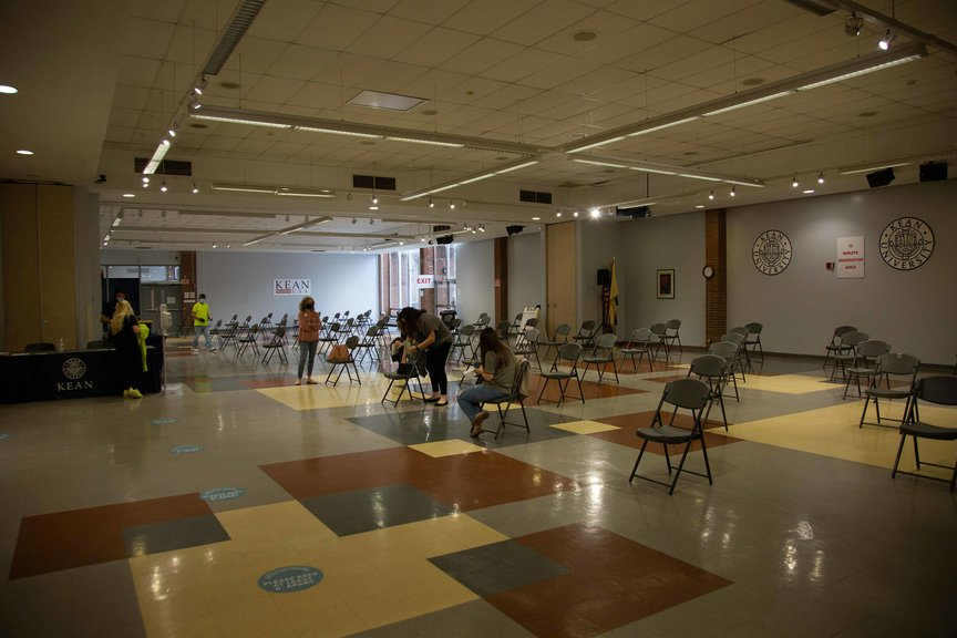 Inside the Kean University vaccine site, which has dozens of chairs socially distanced from each other; only a few people are inside