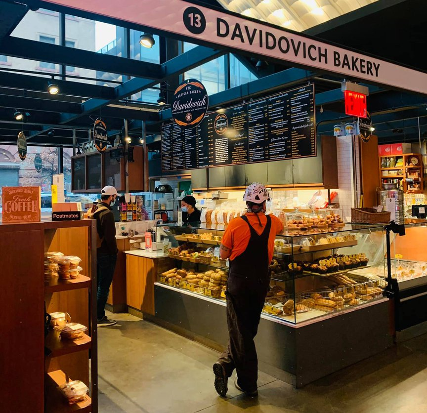 The Davidovich Bakery interior, showing workers and the social distancing markers, at the Essex Market