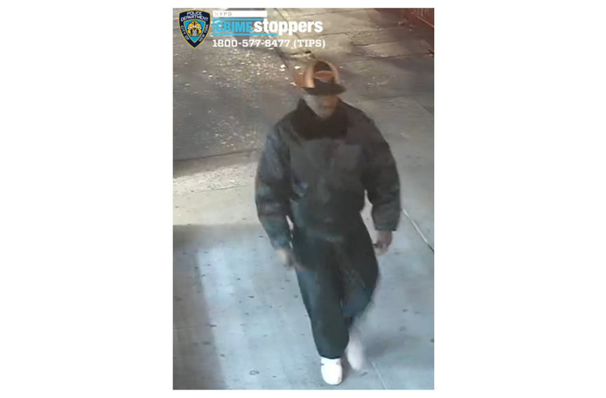 The suspect walking on the sidewalk in a photograph released by the NYPD.