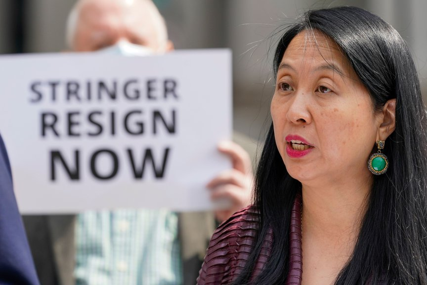 Jean Kim speaks to reporters during a news conference in Manhattan.