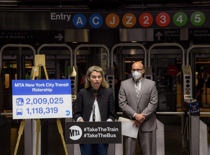 NYC Transit interim president Sarah Feinberg and MTA Bus President and NYCT Senior Vice President of Buses Craig Cipriano at Fulton Street Transit Center; Feinberg is speaking and Cipriano is wearing a mask