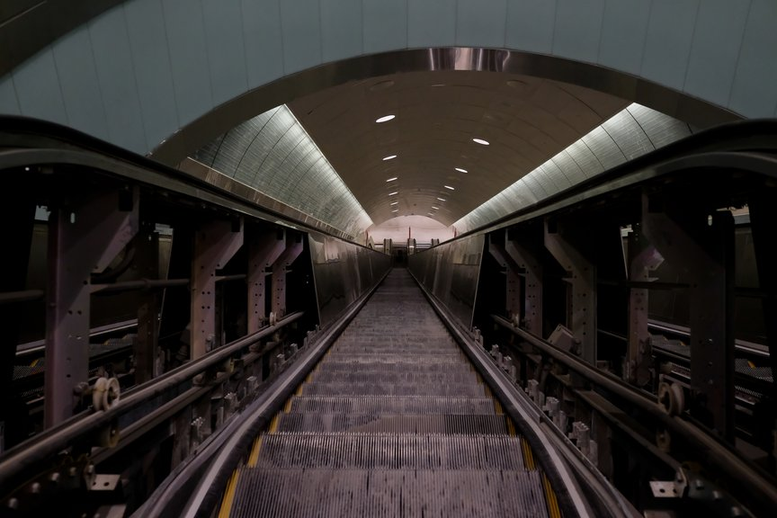 A cavernous escalator tunnel