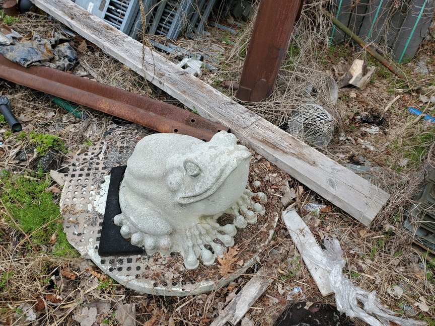 A photo of a frog sculpture being retired