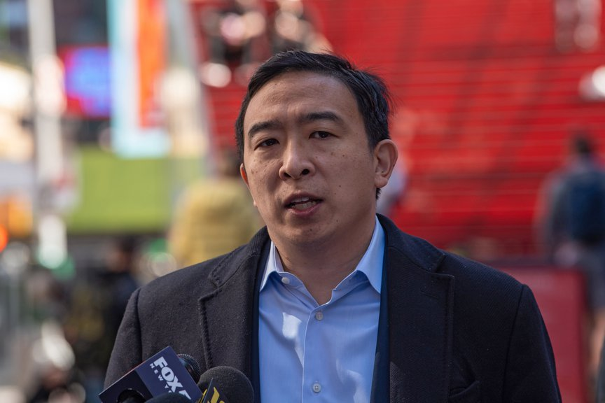 Andrew Yang speaking at Times Square on Sunday.